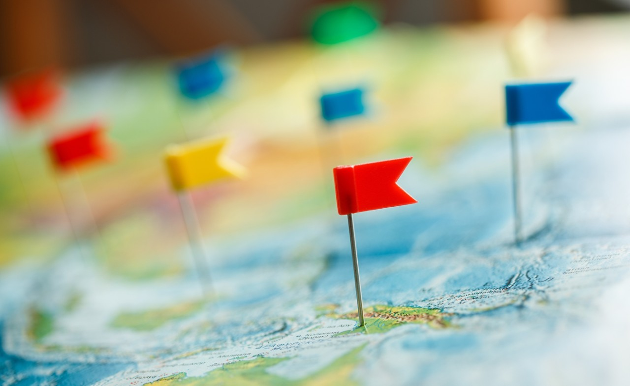 travel-concept-with-colorful-flag-pushpins-and-world-map-horizontal-banner-5472x3356-image-file
