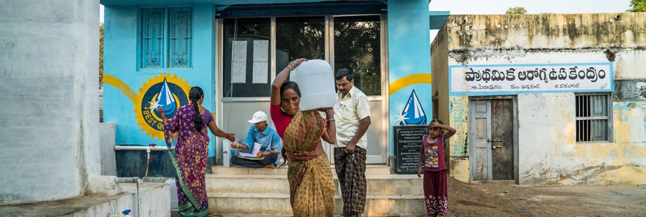 safe-water-network-woman-carrying-water-full-size-horizontal-4240x1425-image-file
