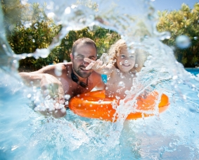 father son in tube in pool